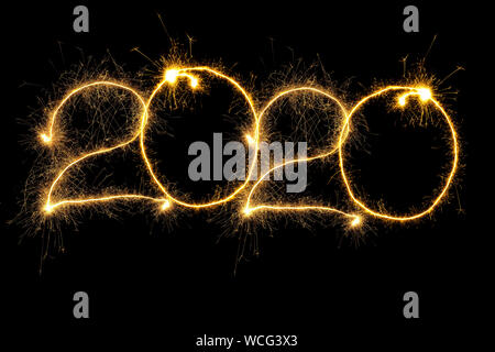 New Year 2020 arranged from sparking digits over black background - Stock Photo