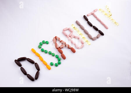Conceptual Hand writing text caption inspiration Medical care Health concept written with pills drugs capsule word disability On white isolated backgr - Stock Photo