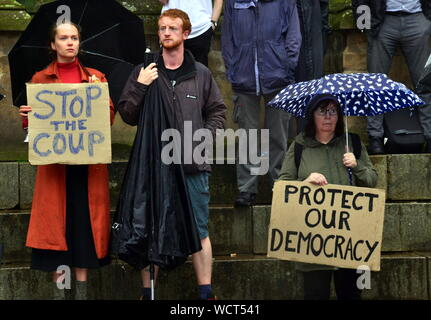 Protesters in Albert Square, beside the Town Hall, in Manchester, uk, on 28th August, 2019, at the Government decision to prorogue Parliament. On this day Prime Minister Boris Johnson successfully sought the Queen's agreement to suspend Parliament, claiming that this is normal before a Queen's speech on the Government's agenda. Protesters argue that this actually aims to reduce the time for Parliament's discussion of Brexit as the uk approaches 31st October and thus damages democracy. - Stock Photo