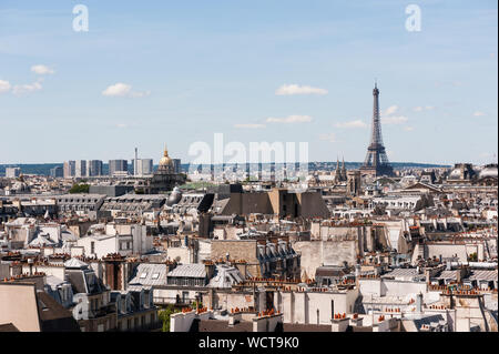 Paris roofs by a sunny afternoon - Stock Photo
