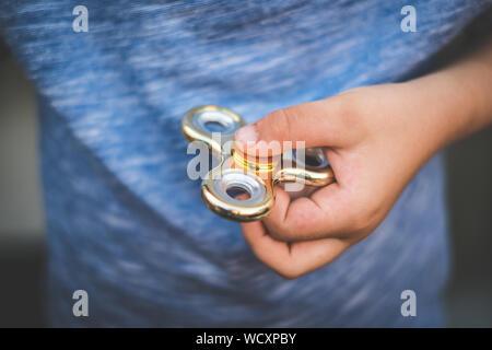 fidget, finger spinner - child holding fidget, finger spinner - Stock Photo