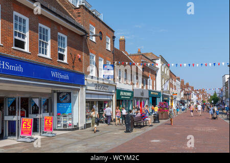 View along busy North Street prosperous shopping area in Chichester, a city and county town of West Sussex, south England, UK on a sunny summer day - Stock Photo