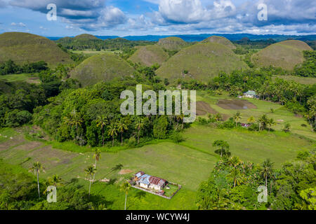 Aerial drone view of the limestone karsts in the Chocolate Hills area of Bohol, Philippines - Stock Photo