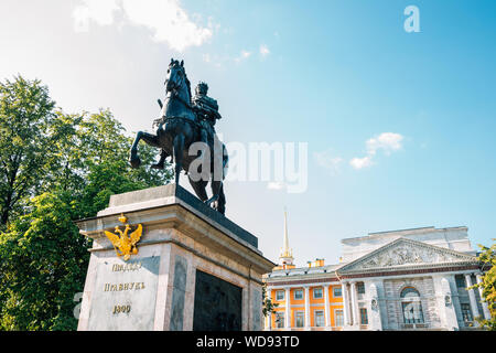 Saint Petersburg, Russia - August 17, 2019 : Monument to Peter I and Saint Michael's Castle - Stock Photo