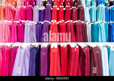 variety of zippers at market - Stock Photo