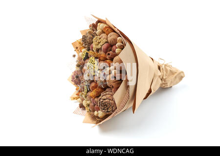 Beautiful handmade gift made of nuts and dried flowers on a white background - Stock Photo