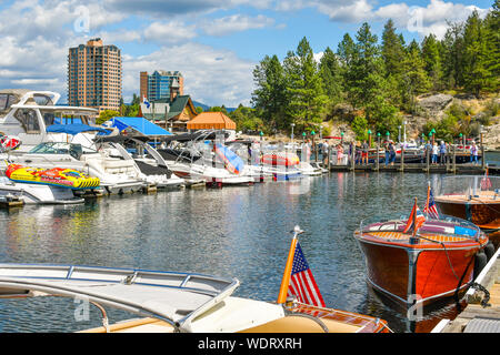 Tourists and locals enjoy the annual wooden boat show at the boardwalk in the mountain town of Coeur d'Alene, Idaho, in the Inland Northwest. - Stock Photo