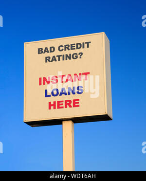 Large outdoor sign advertising instant loans for people with bad credit rating - Stock Photo