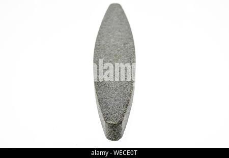 Grindstone or whetstone sharpener on white background. Kitchen utensils - Stock Photo