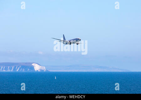 Bournemouth, UK. 30th August 2019. P-8A Poseidon Surveillance Aircraft - Boeing plane specifically developed for the US Navy and modified from the Boeing 737-800 does fly past at Bournemouth Air Festival with its wing span of nearly 40 meters, powered by two turbo fans. Showing the Isle of Wight and the Needles in the distance.  Credit: Carolyn Jenkins/Alamy Live News - Stock Photo