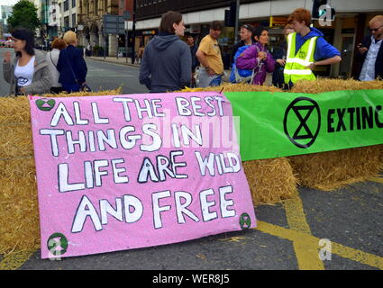 Northern Rebellion protesters, part of the global movement Extinction Rebellion, blocked Deansgate and its side streets in central Manchester, uk, on 30th August, 2019 at the start of a four day protest. The protesters are demanding that the Government tells the truth about the climate emergency, takes action now, and is led by a citizens' assembly on climate change. - Stock Photo