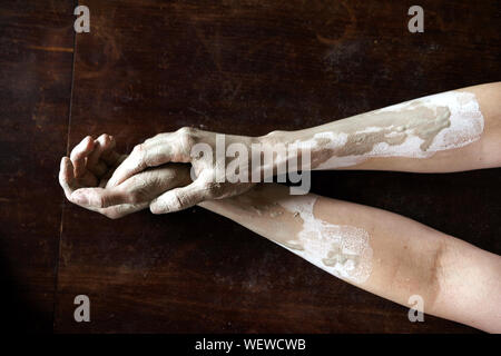 Female hands in a wet clay. Pottery making. - Stock Photo
