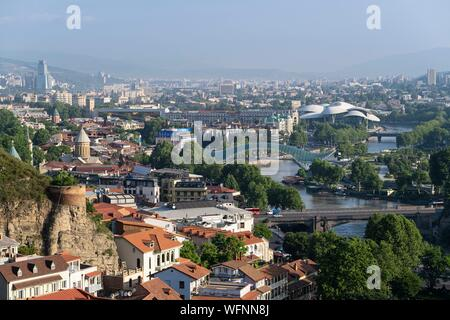 Georgia, Tbilisi, panorama of the city and the Bridge of Peace over the Koura river - Stock Photo