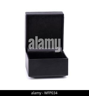 Black jewelry box isolated on white background. Black leather box. Open black gift box isolated on white background. - Stock Photo