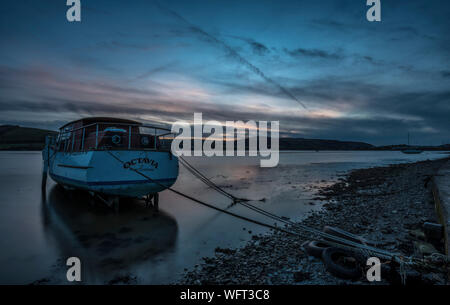 Sunset with boats at low tide on the Teifi estuary - Stock Photo