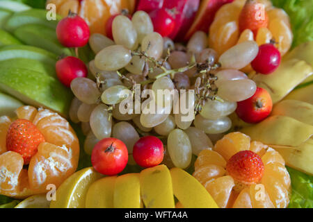 Fruit background .White grapes, red apples, tangerines, strawberries, lemons. Fresh fruits.Assorted fruits colorful background.slices of colourfull fr - Stock Photo