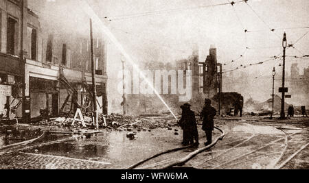 Firemen tackle a fire in St George's Crescent off Lord Street during the German Blitz on Liverpool between August 1940 and January 1942. - Stock Photo
