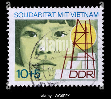 Stamp printed in GDR dedicated to solidarity with Vietnam, circa 1973. - Stock Photo