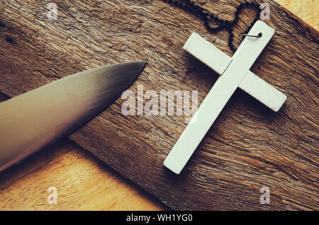cross on wooden table - Stock Photo