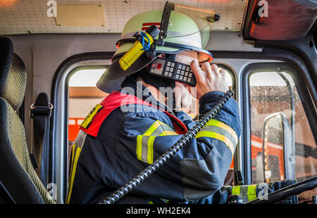 Firefighter in action and used a radio - HDR - Stock Photo