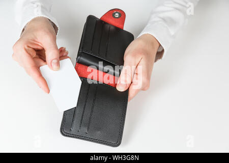 Woman hand hold and bring out card in her purse - Stock Photo
