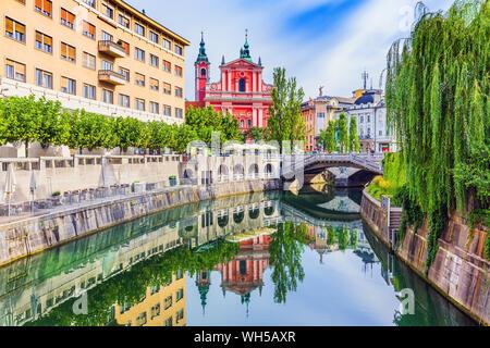 Ljubljana, Slovenia. Cityscape on Ljubljanica river canal in old town. - Stock Photo