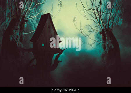 Halloween night background with spooky forest trees and witch house in fog. - Stock Photo