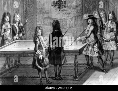Louis XIV playing billiards. with Monsieur, the Ducs de Chartres, Toulouse, Vendome, and MM. d'Armagnac and Chamillart.  Engraving by A. Trouvain - Stock Photo
