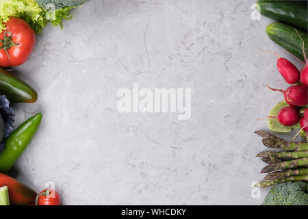 Organic food background, fresh vegetables on gray marble background, healthy food and clean eating concept with copy space, natural condition, top vie - Stock Photo