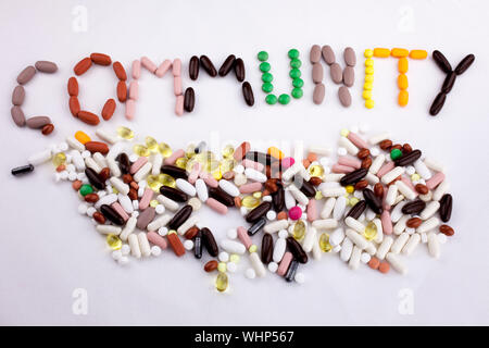 Conceptual Hand writing text caption inspiration Medical care Health concept written with pills drugs capsule word community On white isolated backgro - Stock Photo