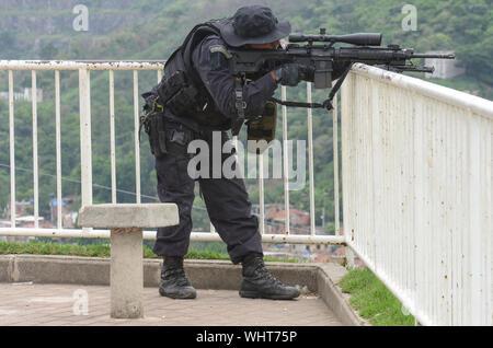 RIO DE JANEIRO, BRAZIL, MARCH, 21, 2015: Rio de Janeiro military police with snipers patrolling the German complex, slum complex - Stock Photo