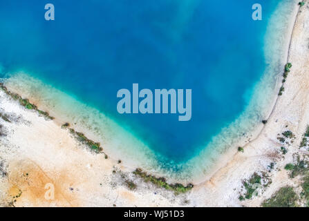 Aerial photograph with drone, corner of a gravel pond with sandy beach - Stock Photo