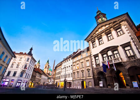 Evening panoramic view of Ljubljana's historic city center and the town hall. - Stock Photo