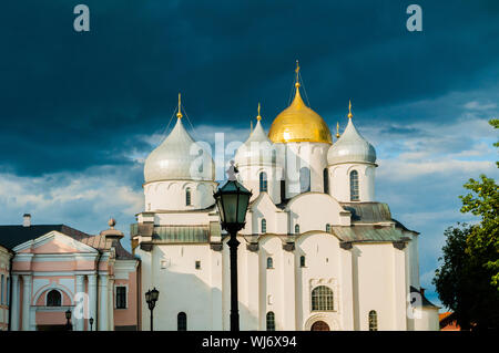 Veliky Novgorod, Russia. Saint Sophia Cathedral domes, closeup facade view of Veliky Novgorod landmark on the background of evening dramatic clouds - Stock Photo