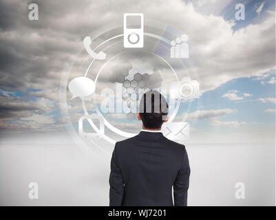 Composite image of businessman turning his back to camera - Stock Photo