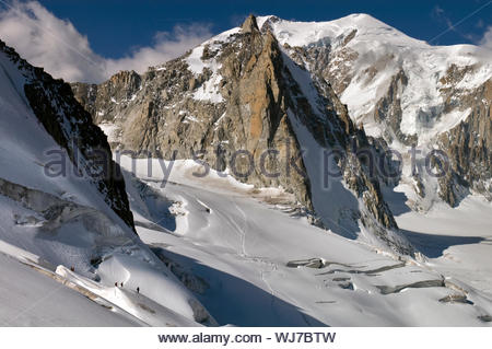 Mont Blanc overhangs la Tour Ronde north face and Glacier du Géant, Chamonix, France - Stock Photo