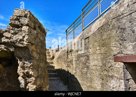 Staiway leading from and into the bunker at Pointe du Hoc - Stock Photo