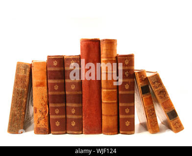 Old antique books against a white background - Stock Photo