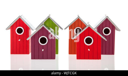 Colorful bird houses in a row isolated over white background - Stock Photo