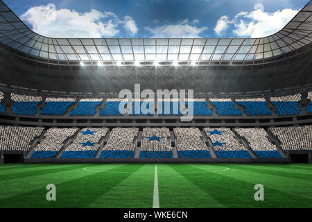 Digitally generated honduras national flag against large football stadium - Stock Photo