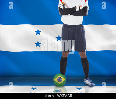 Composite image of goalkeeper in white with ball against digitally generated honduras national flag - Stock Photo