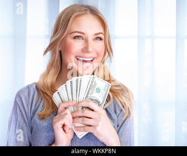 Portrait of happy excited woman holding in hands lot of money, at home, financial success, wealth concept - Stock Photo