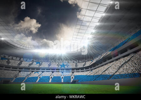 Digitally generated honduras national flag against football stadium with fans in white - Stock Photo