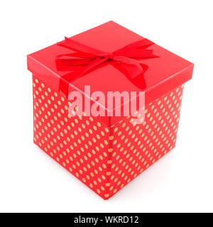 red gift box dotted with yellow isolated over white - Stock Photo