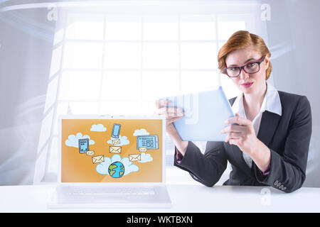 Redhead businesswoman using her tablet pc against room with large window showing city - Stock Photo
