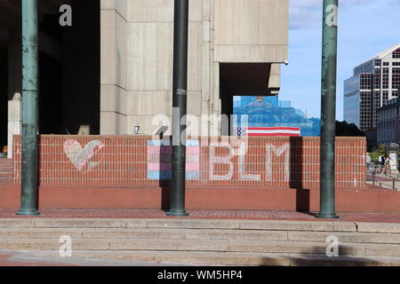 Chalk bisexual Pride flag, heart, and Black Lives Matter Logo on steps in front of Copley Square after the Boston Straight Pride Parade in August 2019 - Stock Photo