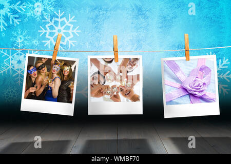 Casual business team toasting with champagne against close up of blue gift box with purple ribbon - Stock Photo