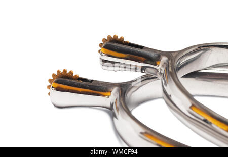 riding  spurs with golden stars isolated. close up - Stock Photo