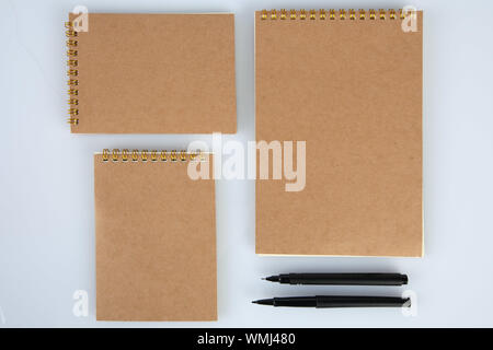 Set of notepads with black pens for mockups. Top view with copy space - Stock Photo