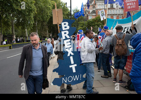 Pro Brexit Leave campaign protesters with messages that We Voted Leave and General Election Now in Westminster on the day after Parliament voted to take control of Parliamentary proceedings and prior to a vote on a bill to prevent the UK leaving the EU without a deal at the end of October, on 5th September 2019 in London, England, United Kingdom. Yesterday Prime Minister Boris Johnson faced a showdown after he threatened rebel Conservative MPs who vote against him with deselection, and vowed to aim for a snap general election if MPs succeed in a bid to take control of parliamentary proceedings - Stock Photo